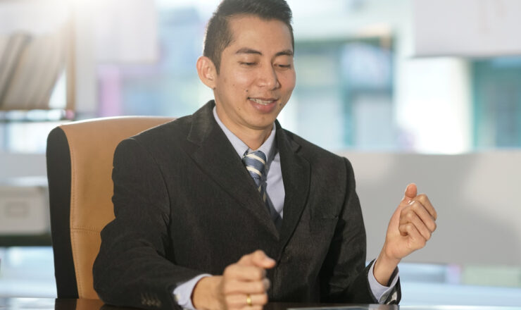 Successful Asian businessman at work in office